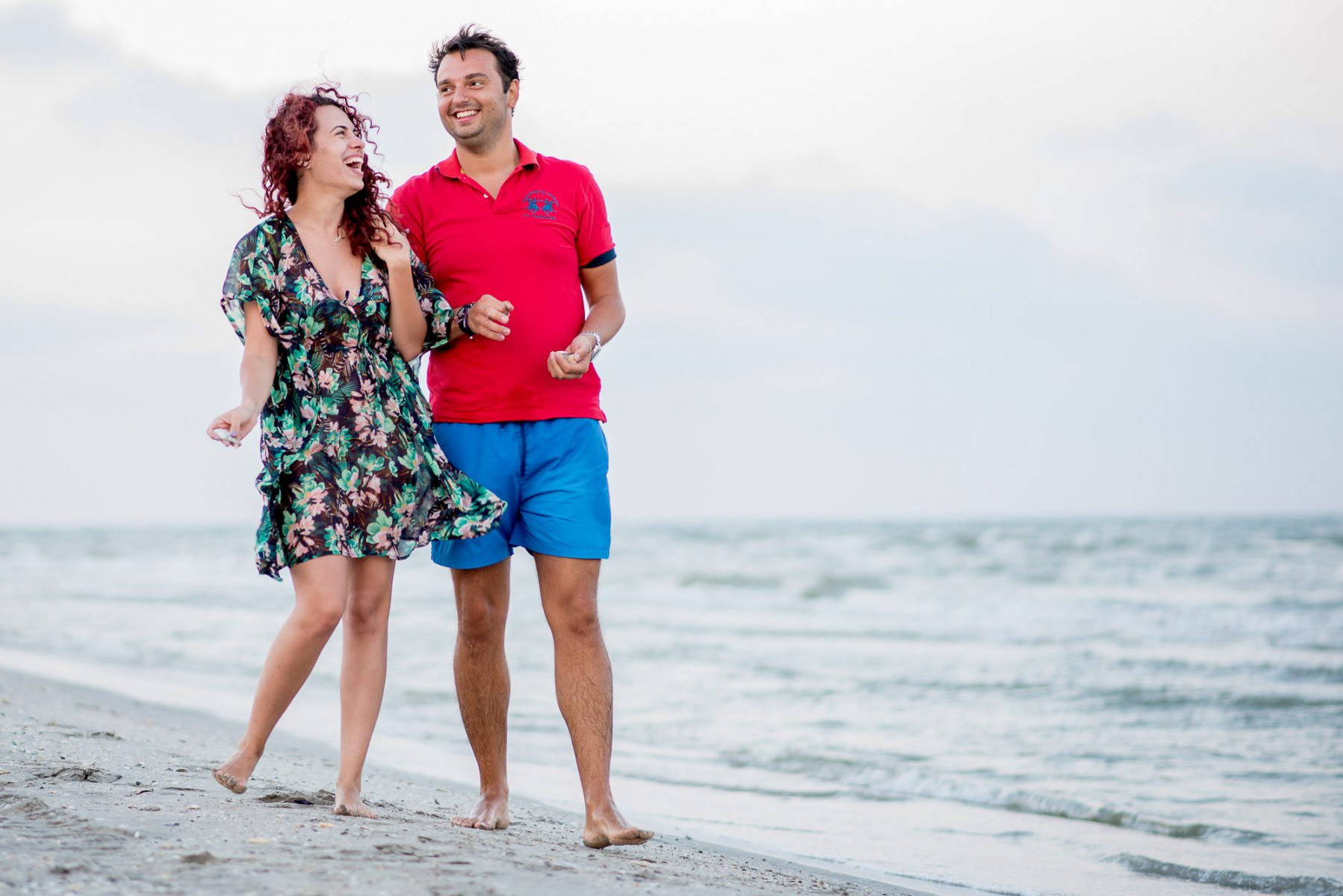couple laughing on a beach photo shoot