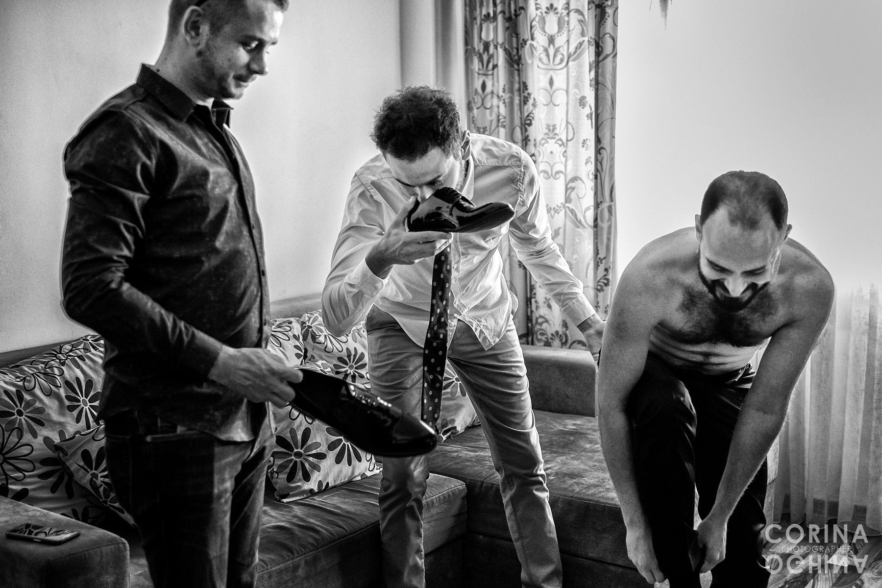 Humorous photo of Groom getting ready for wedding day