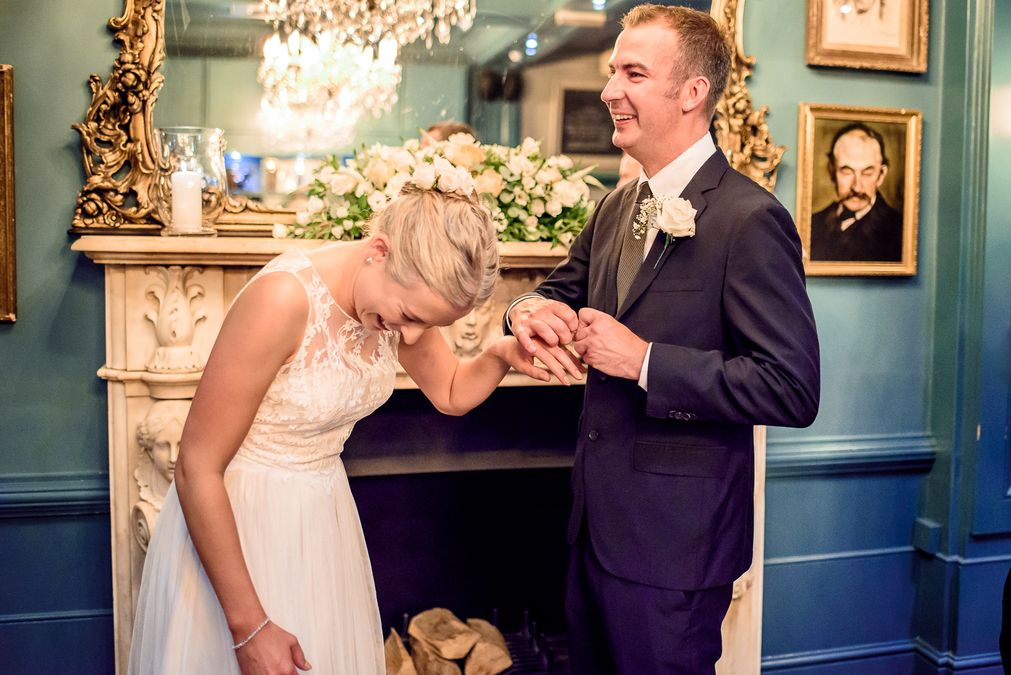 bride and groom exchanging rings at The County Arms
