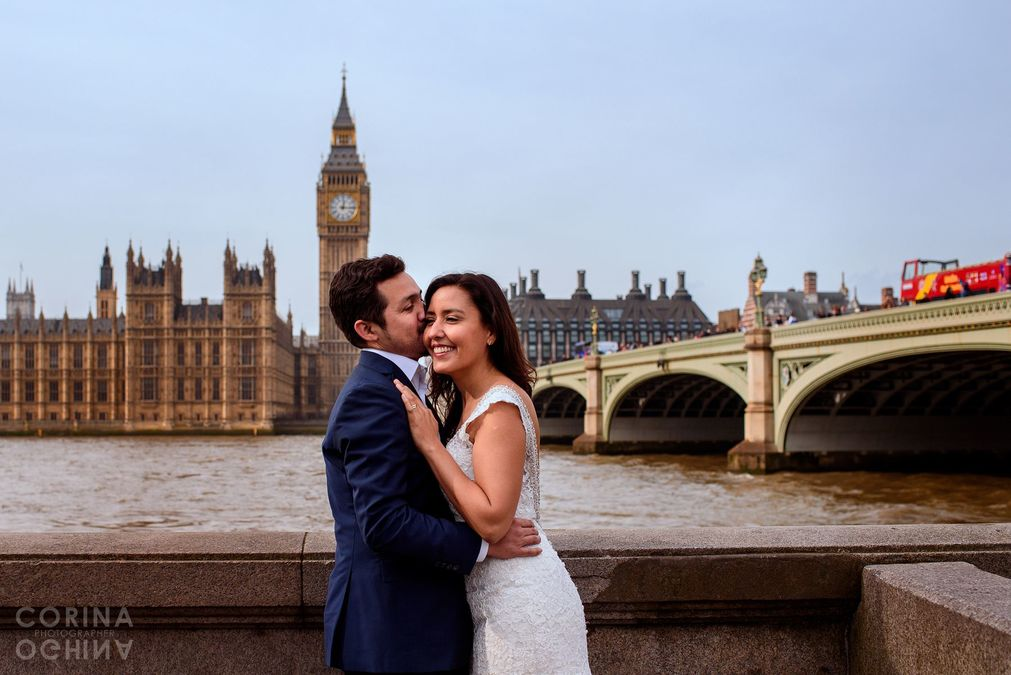 couple hugging in front of Big Ben London on a photo shoot