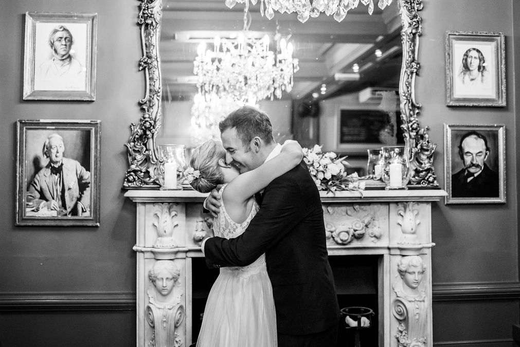 Couple hugging at The County Arms Pub on their wedding