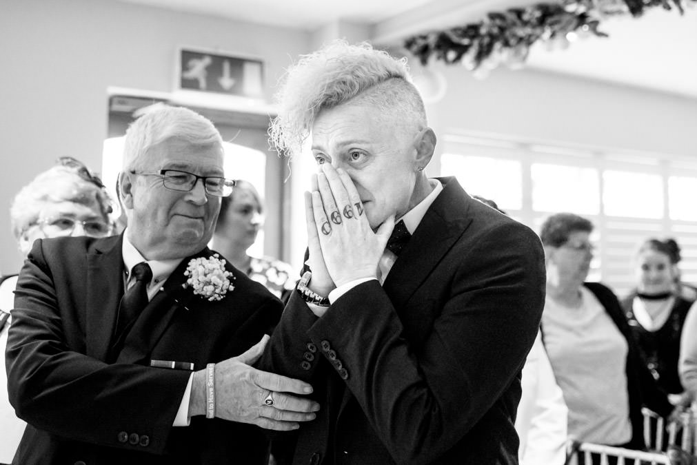 Lesbian being supported by her dad while waiting for the bride