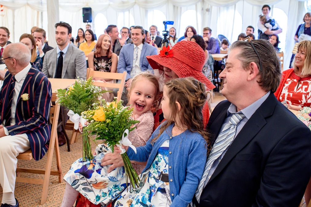 kids laughing at a festival wedding