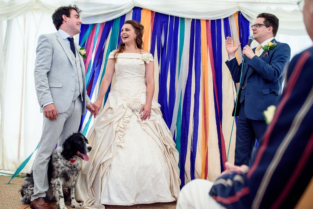 dog bringing rings at Festival wedding at The Barleylands