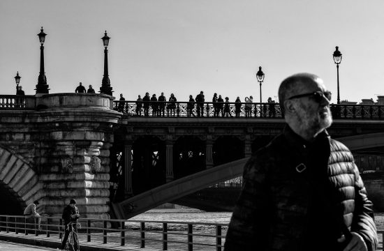 Silhouettes on a bridge in Paris