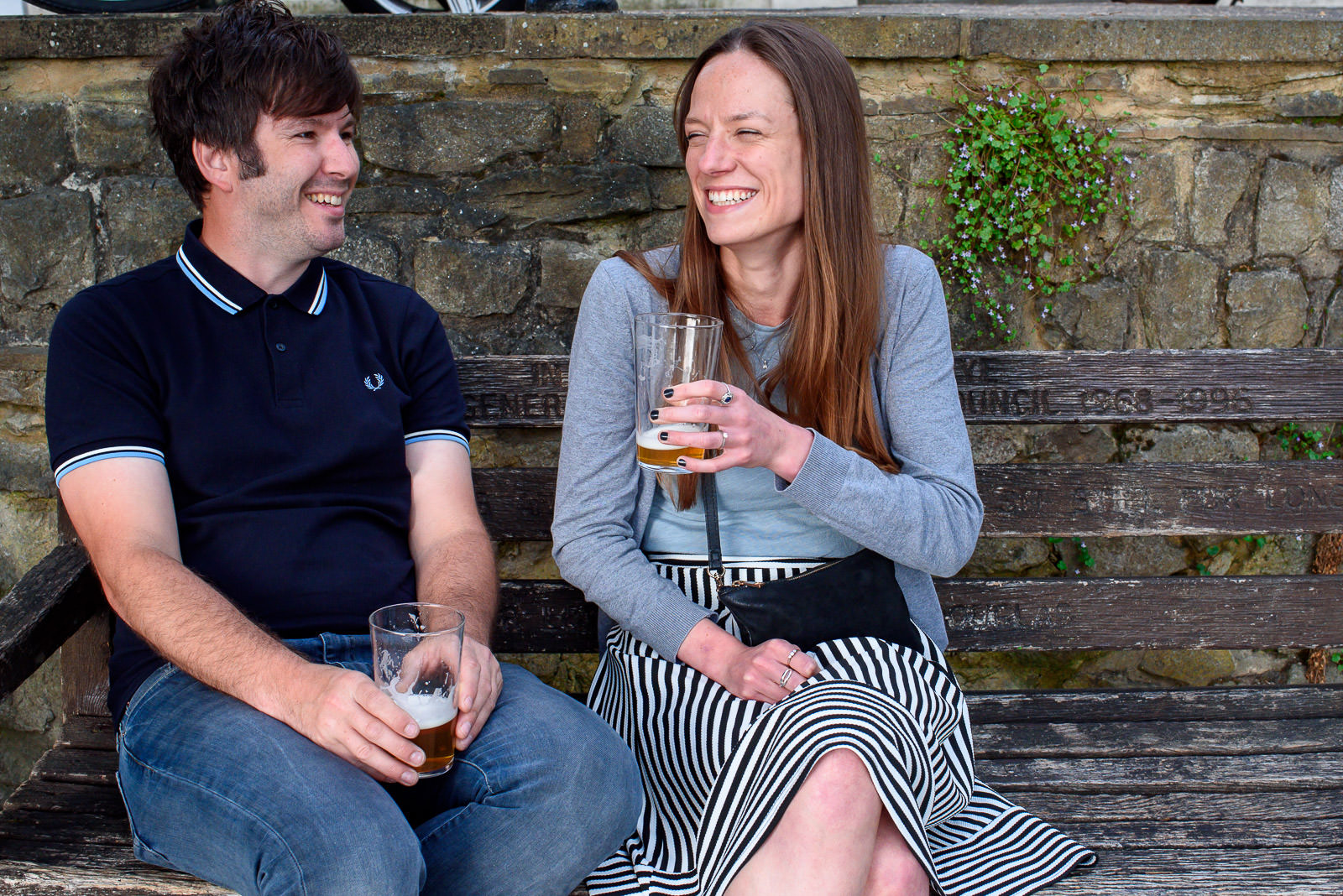 couple enjoying a pint on their engagement photo shoot