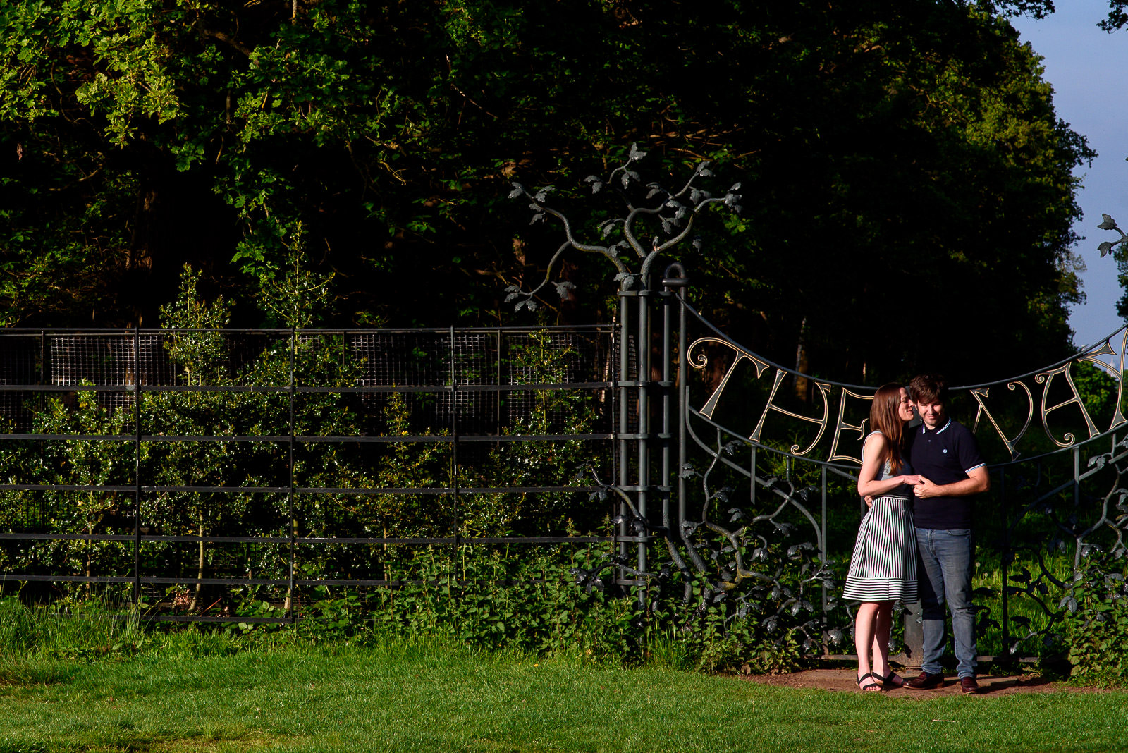 couple shoot in Richmond Park with the Way gate