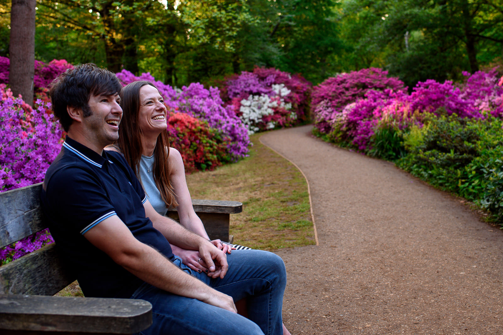 couple sittling on a bench in Isabella Plantation