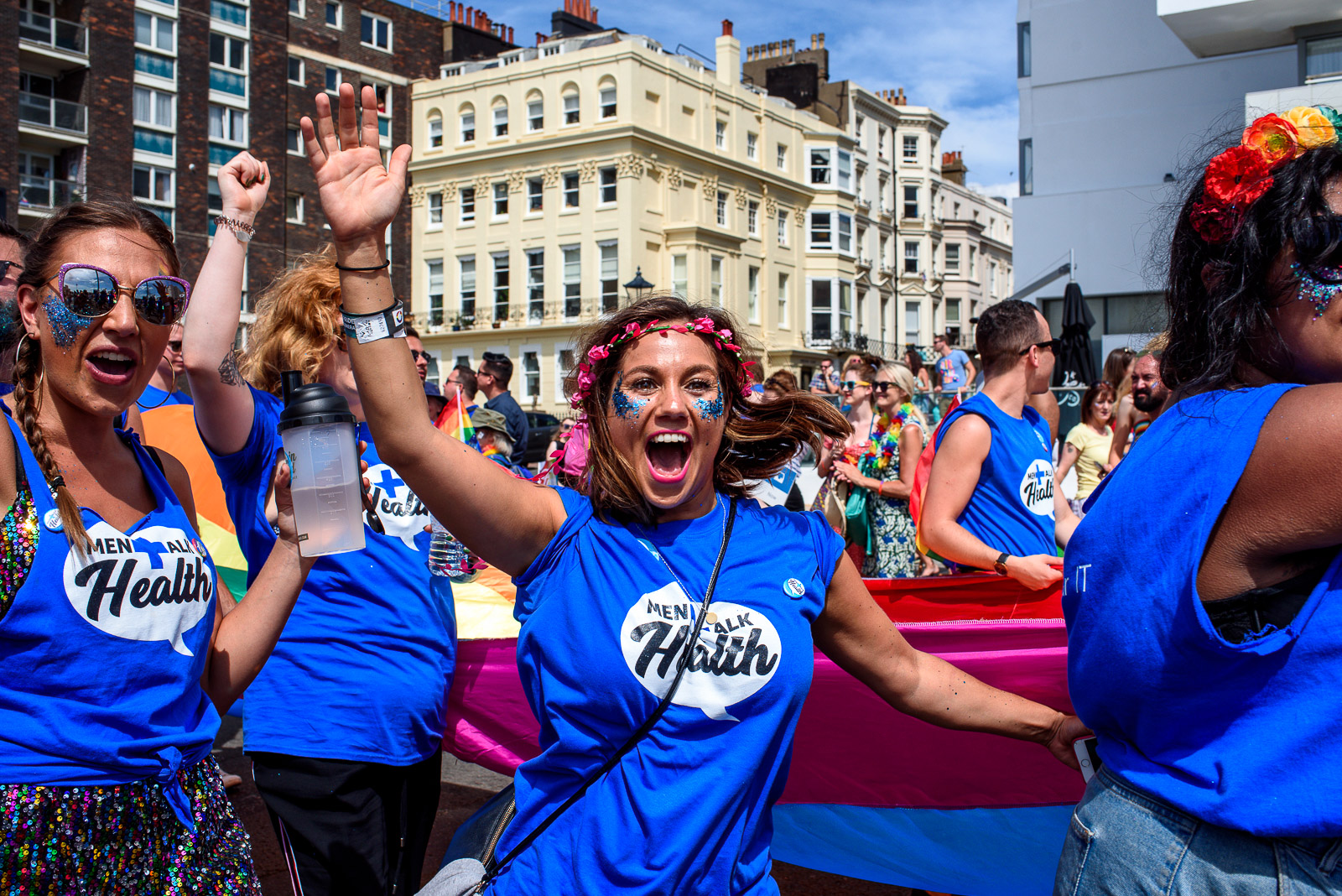 Girl raising awareness for mental health at the Brighton Pride Parade