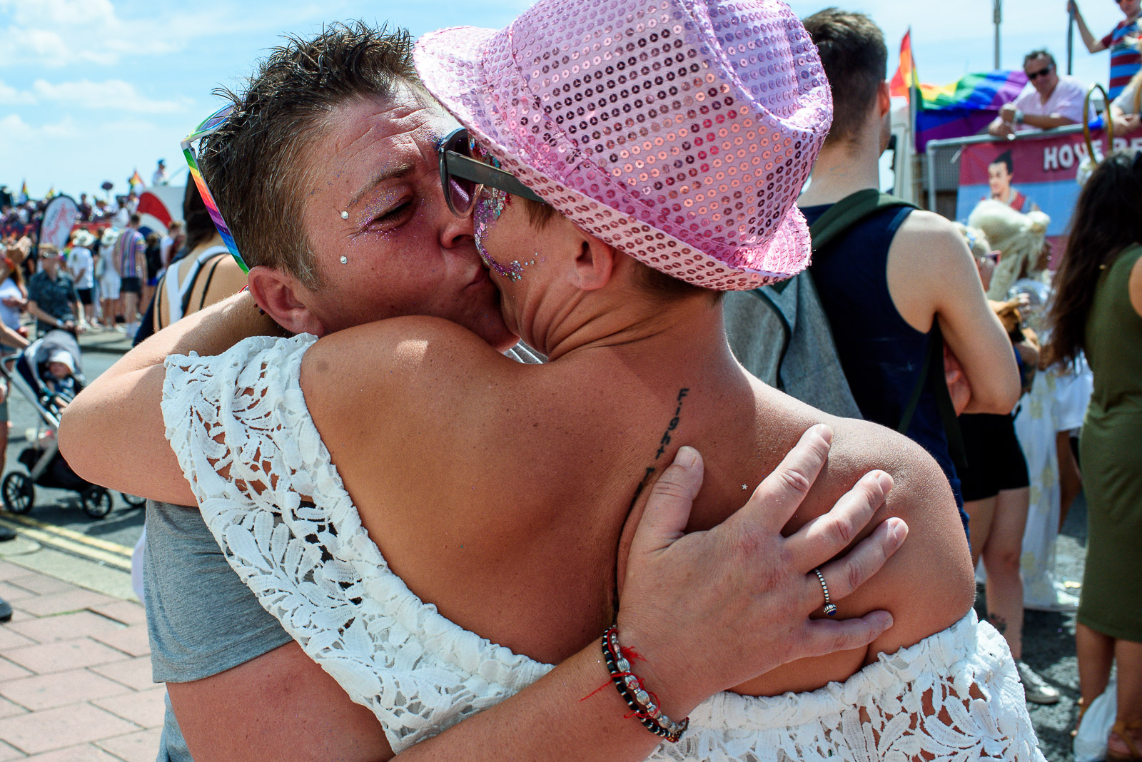 Girls kissing while attending Brighton Pride Parade