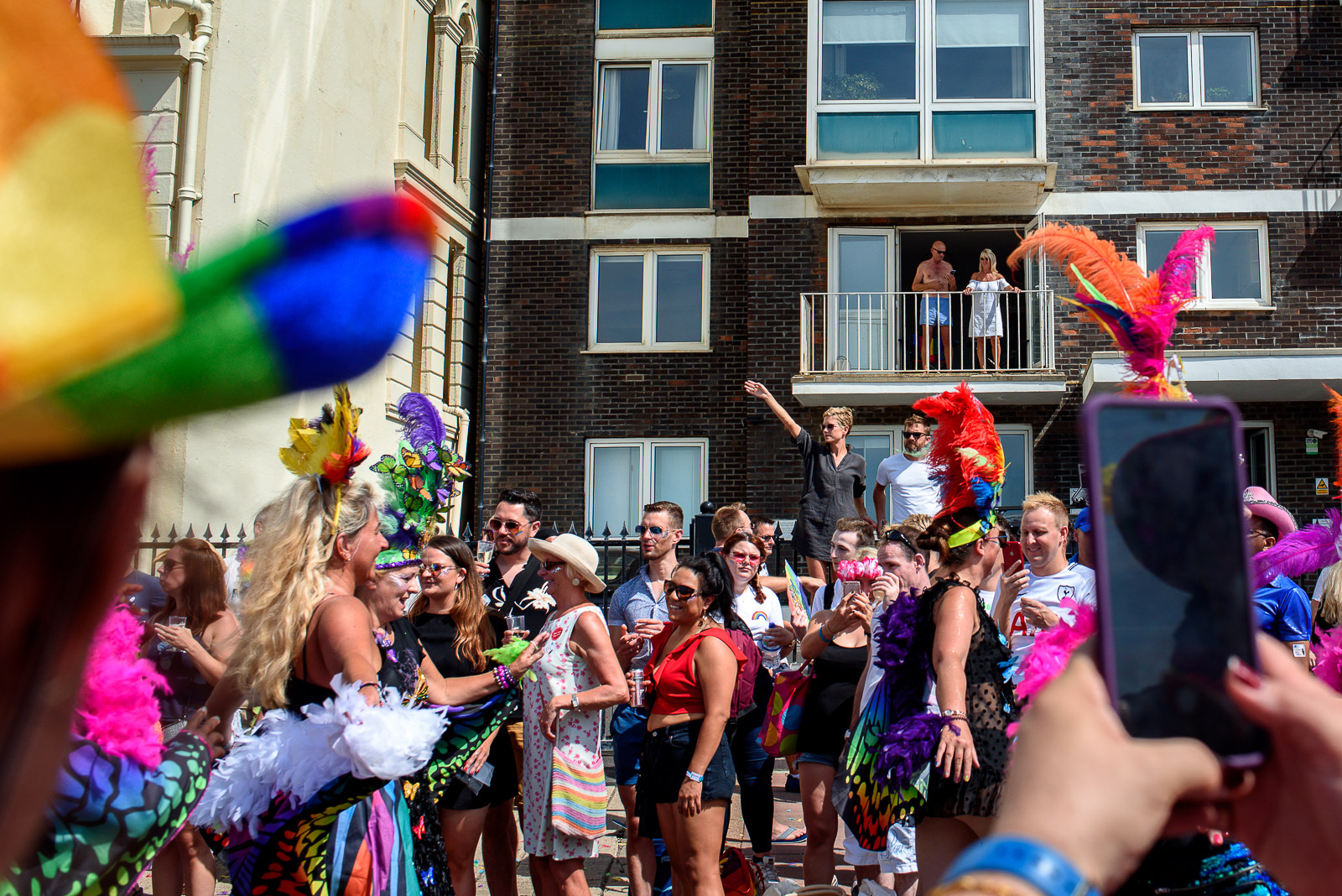 Group of people cheering at the Brighton Pride Parade