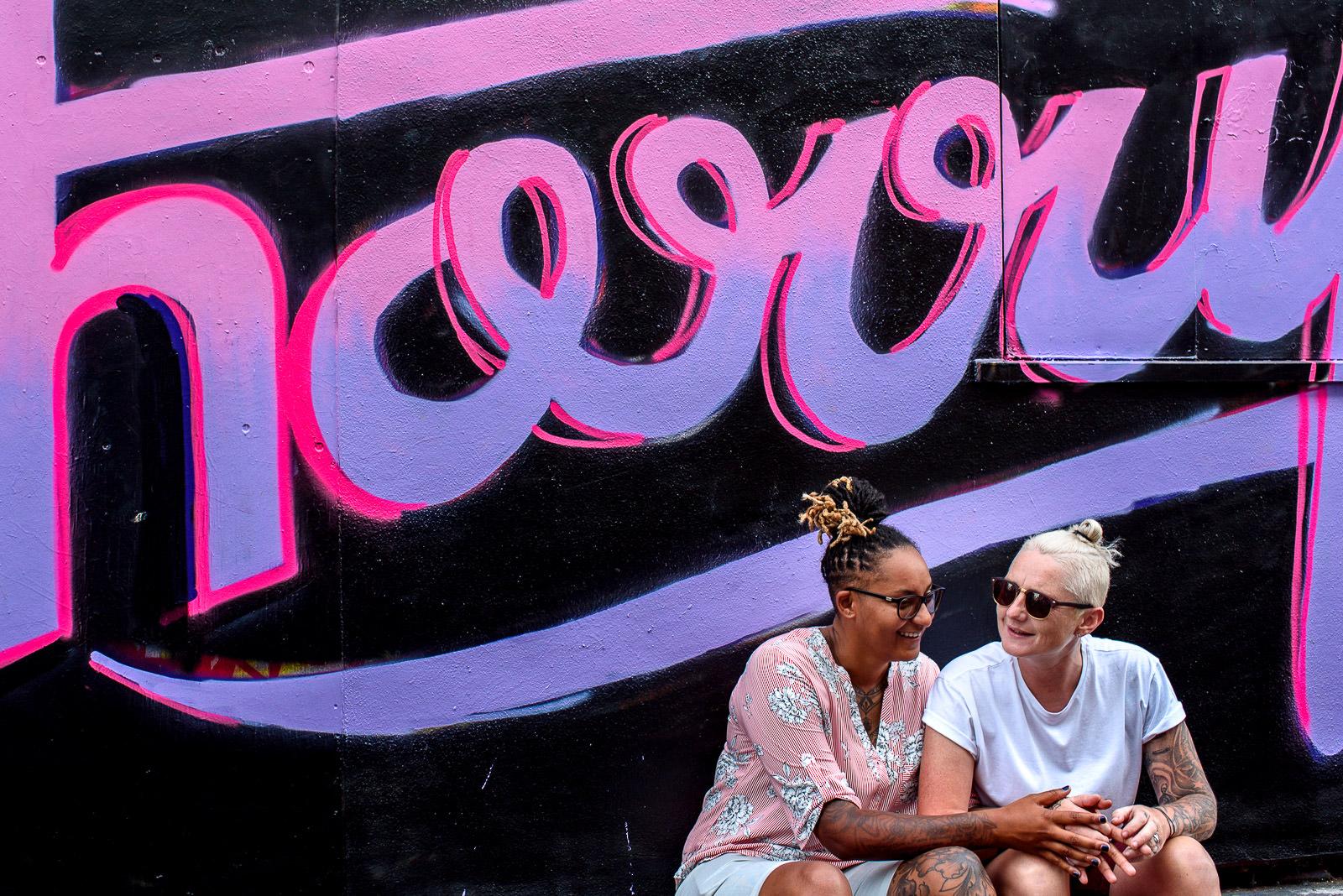 same sex couple photo shoot in Brighton next to a grafiti