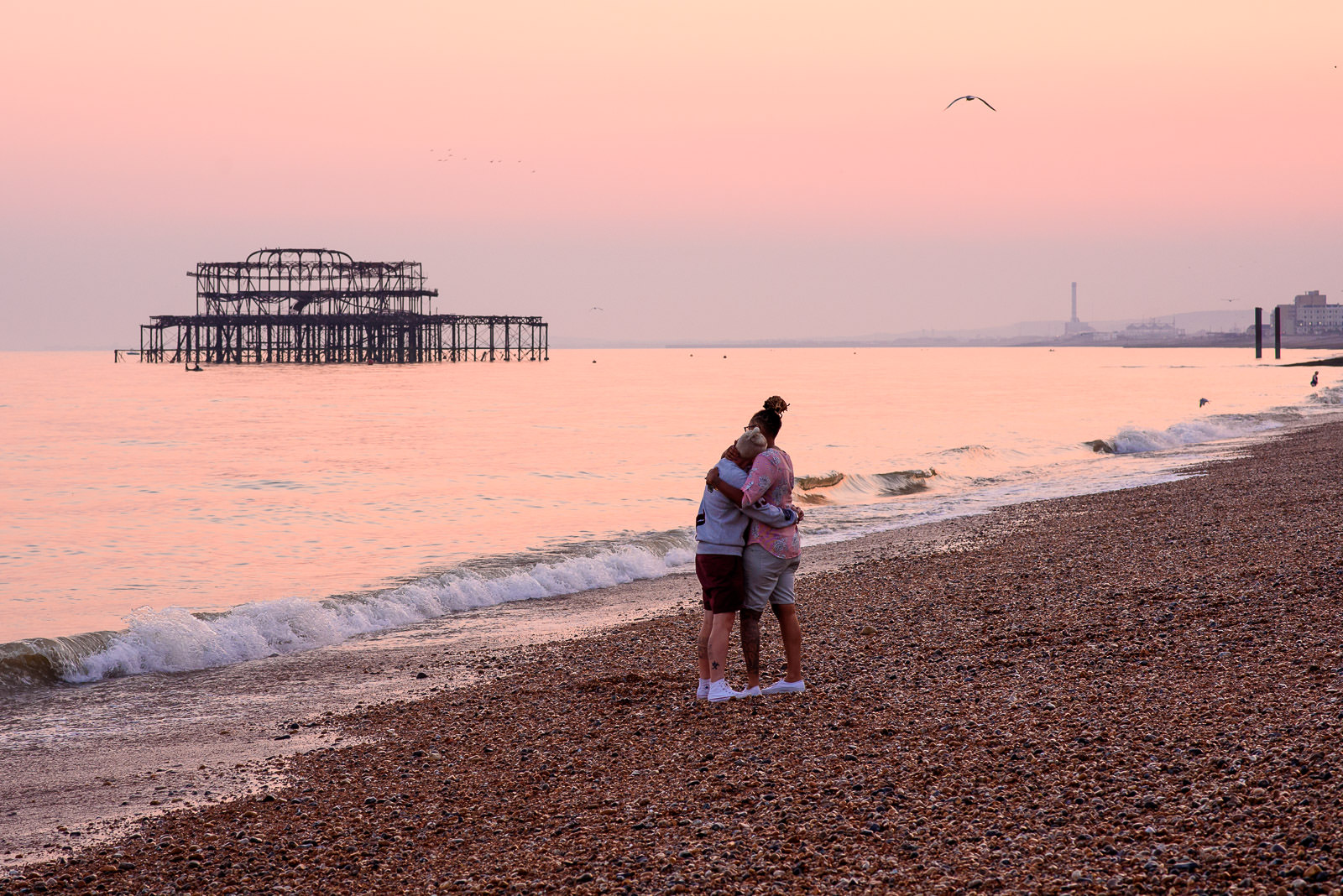same sex couple photo shoot with the west pier in Brighton at sunset