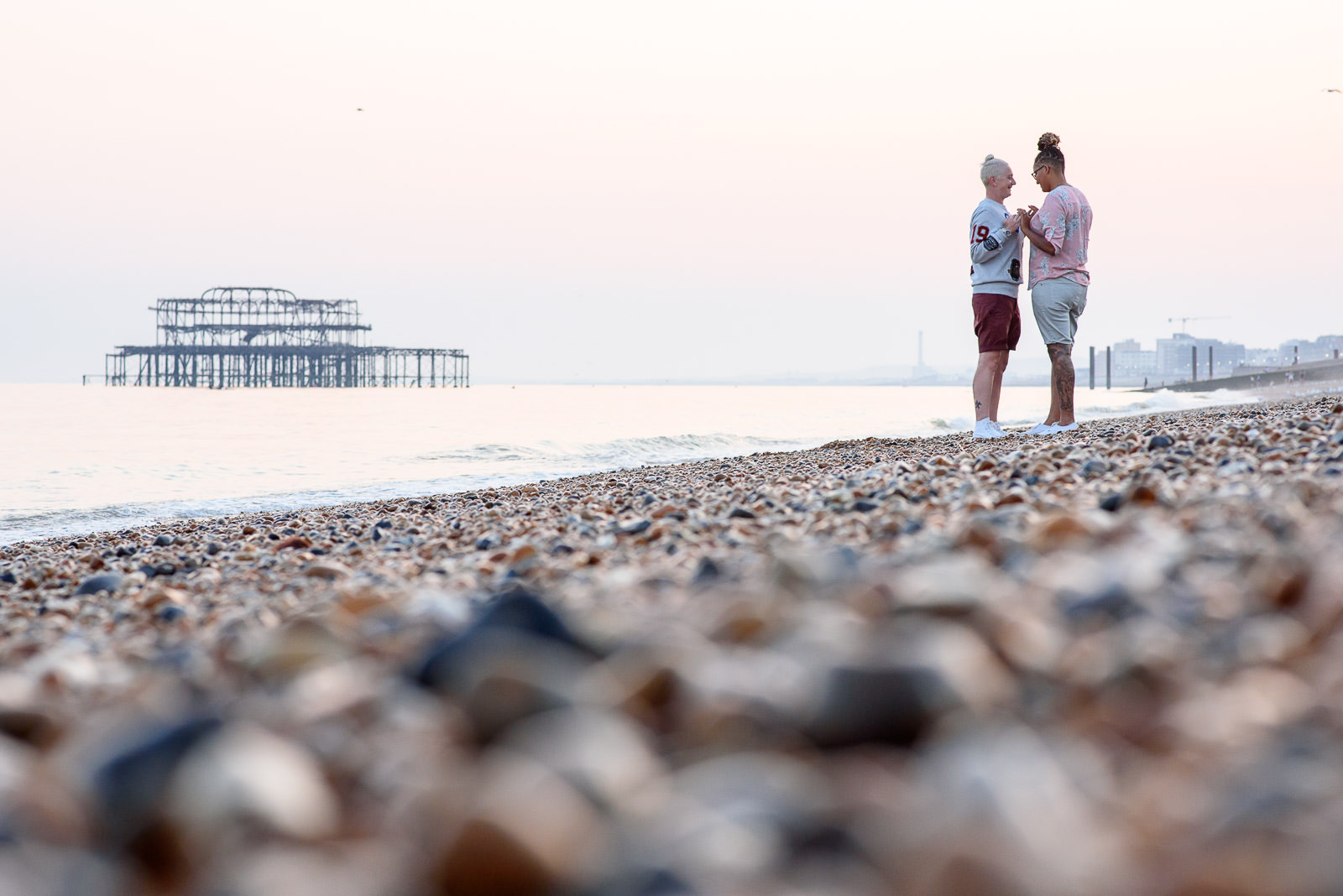 couple photo shoot location on Brighton beach with West Pier