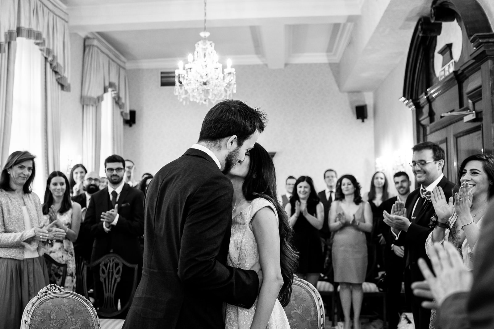 First kiss at wedding ceremony at Chelsea Old Town Hall