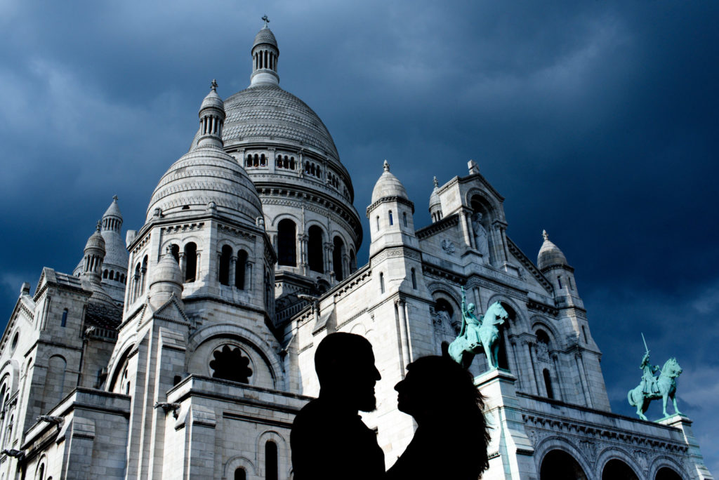 Silhouette over Sacre Cour Paris couple photo shoot