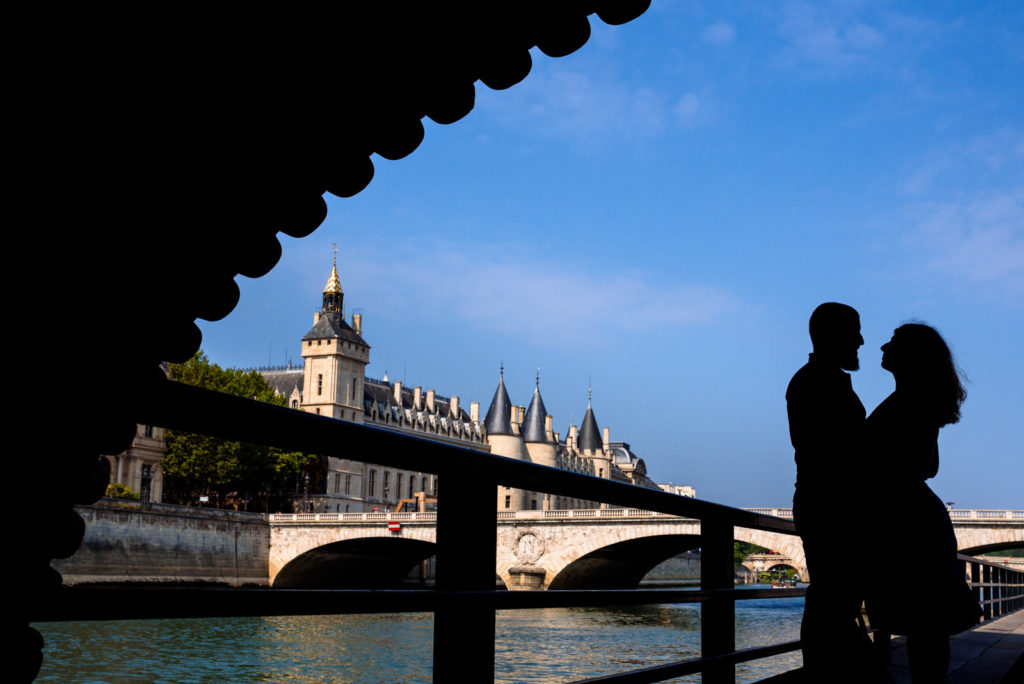 Silhouette of couple hugging in Paris
