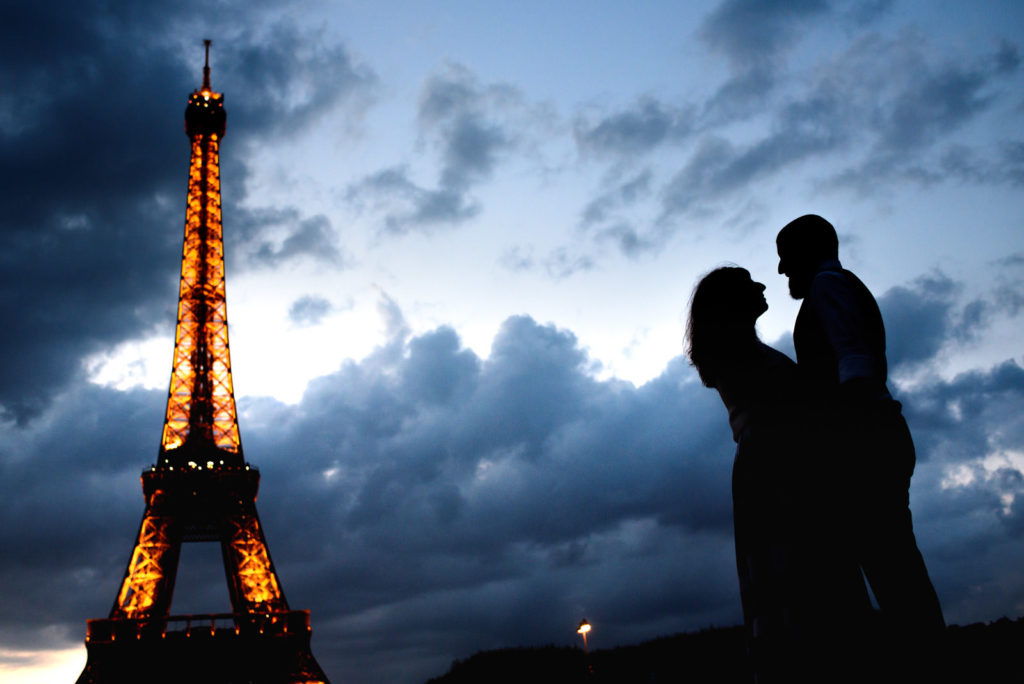 Night shot of Eiffel Tower and couple silhouette