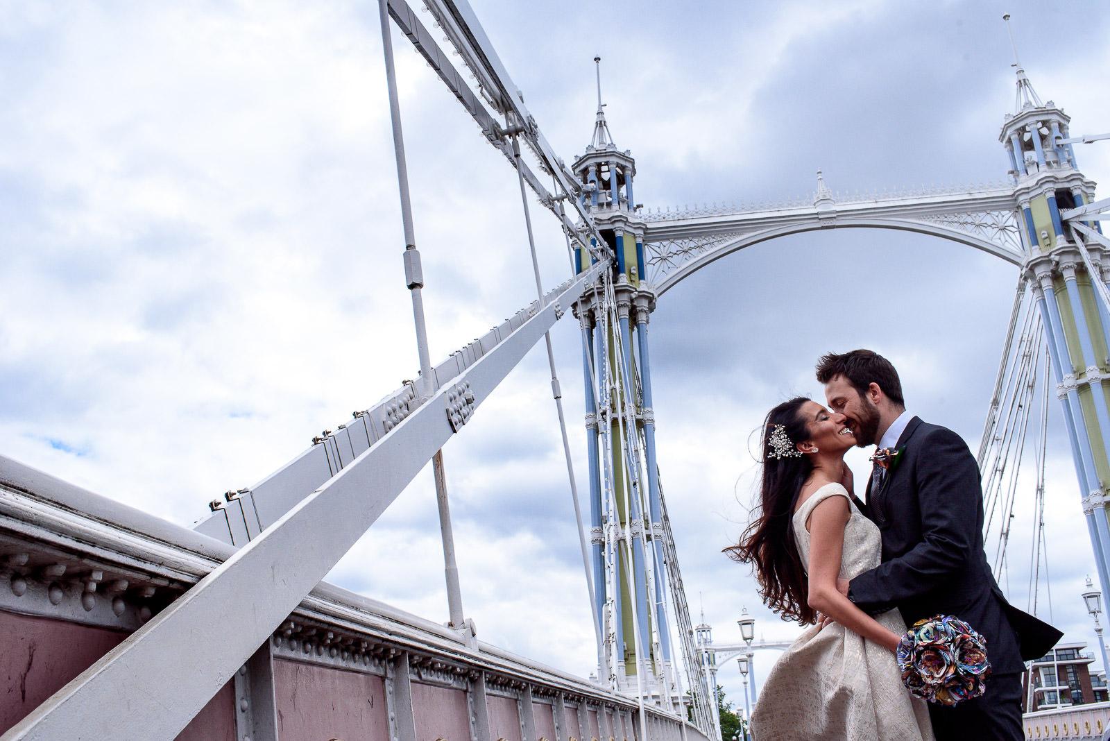 Couple taking wedding photos on Albert Bridge in London
