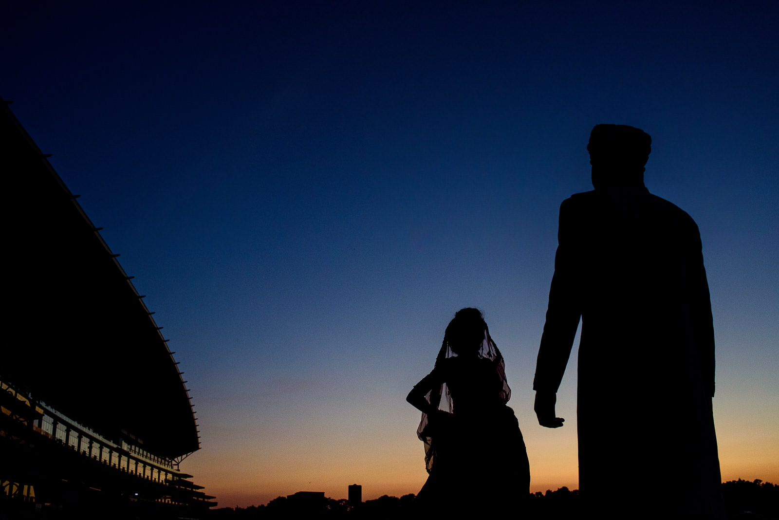 Sunset silhouettes on indian wedding in London