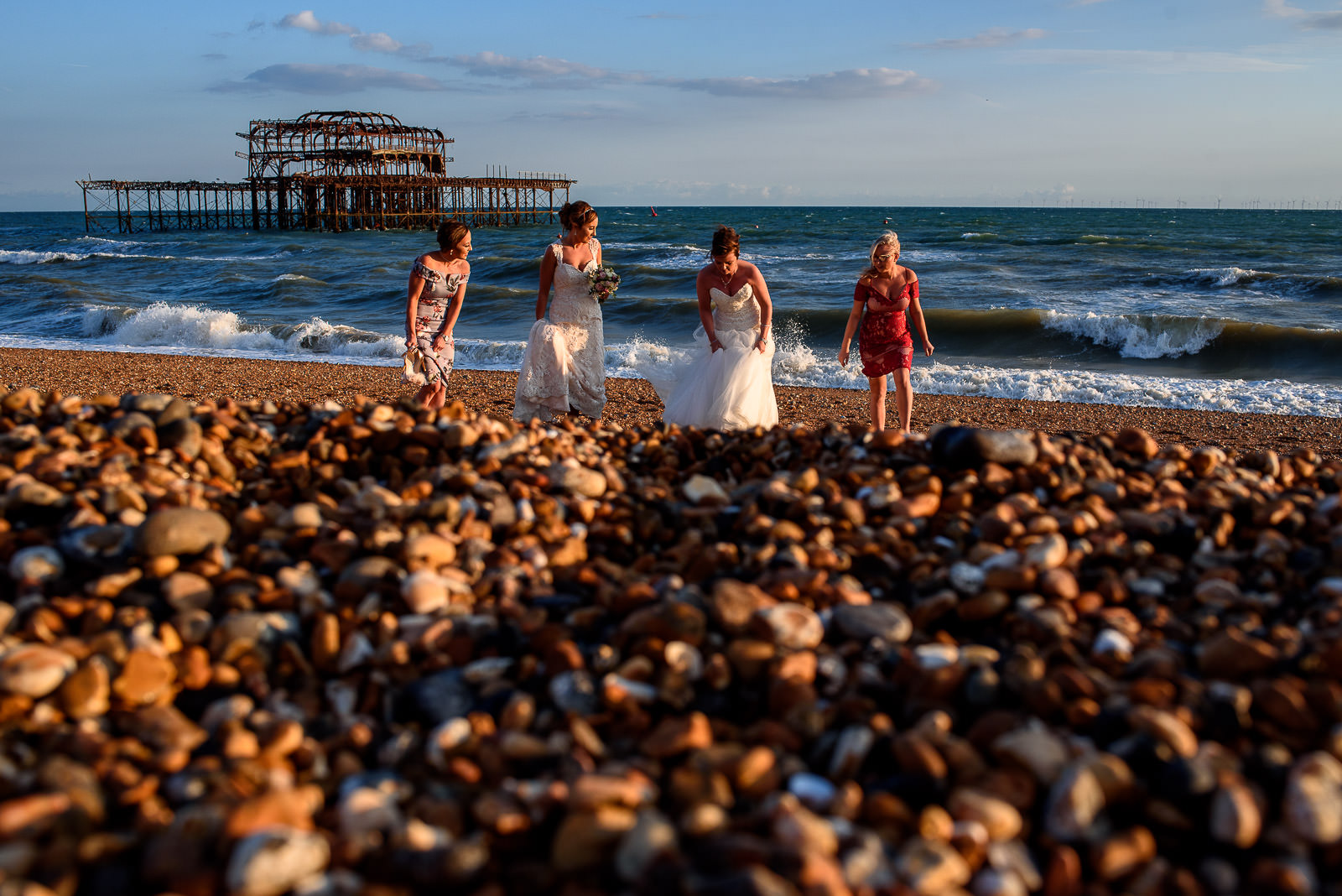 Wedding party on the Brighton Beach with the West Pier ruins