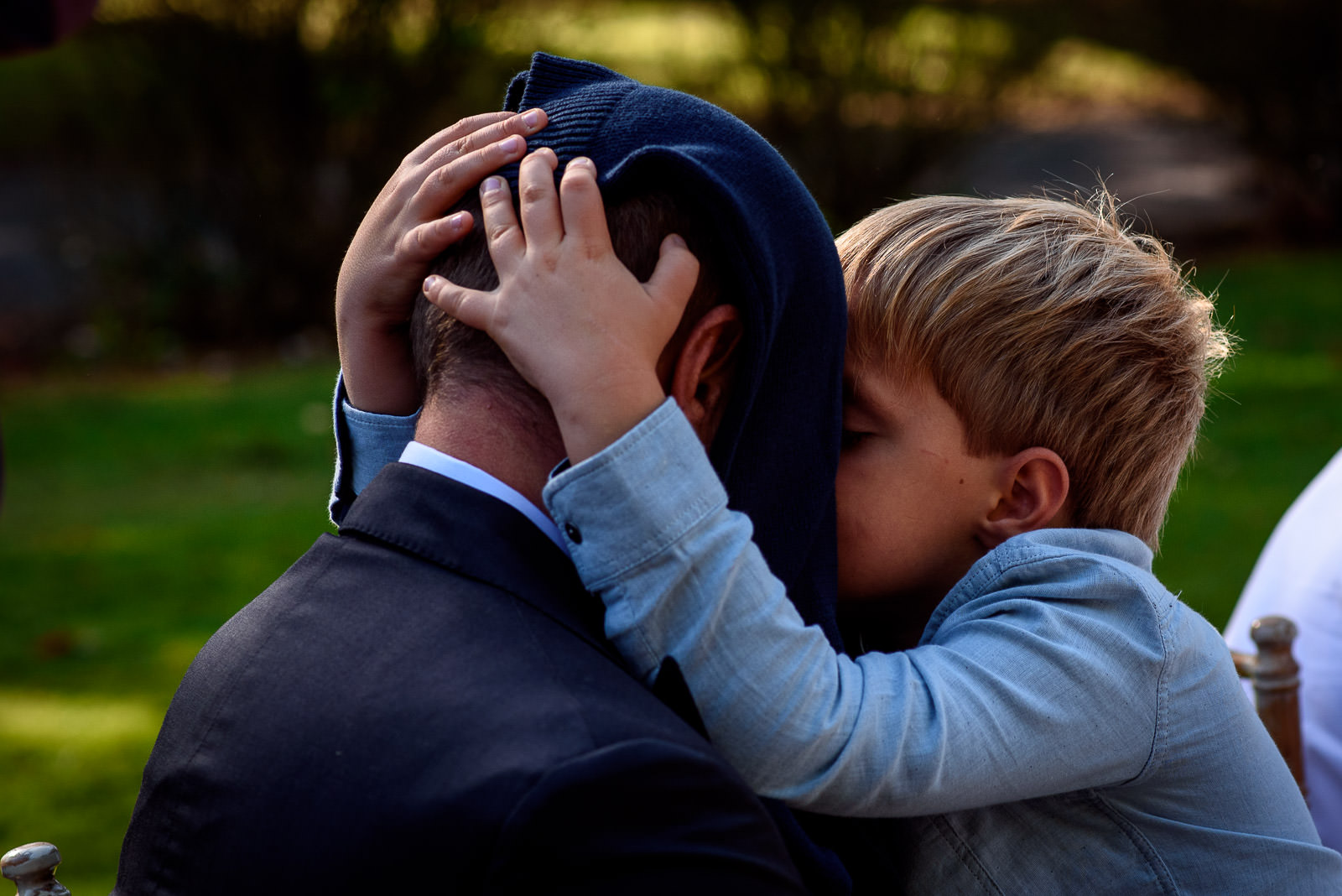 kid hugging dad at a wedding in Brighton
