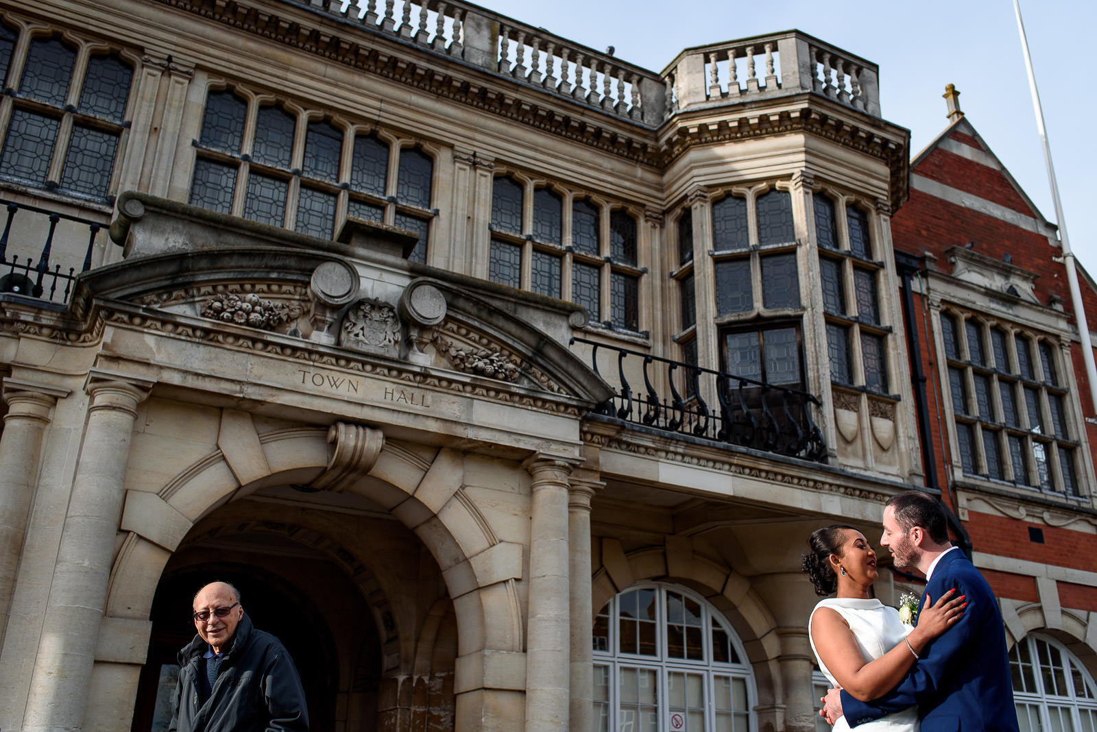 bride and groom taking photos at Hendon Town Hall