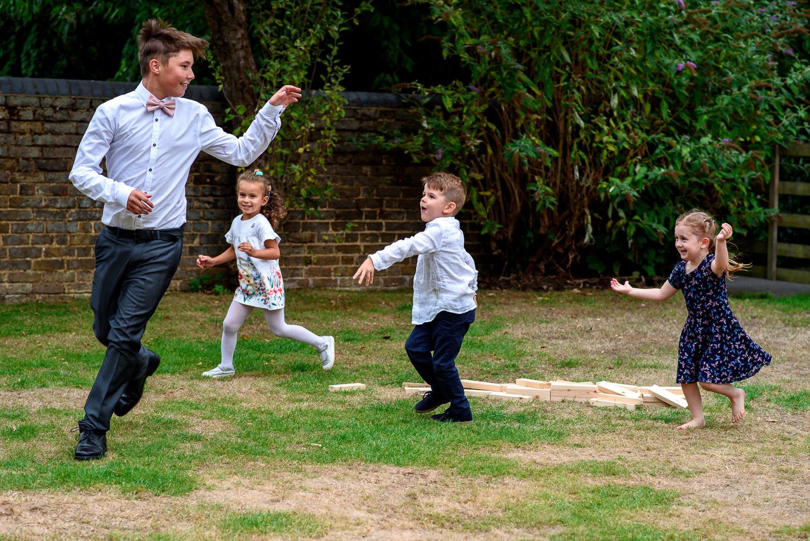 kids playing at wedding in Oaks Farm Wedding Croydon