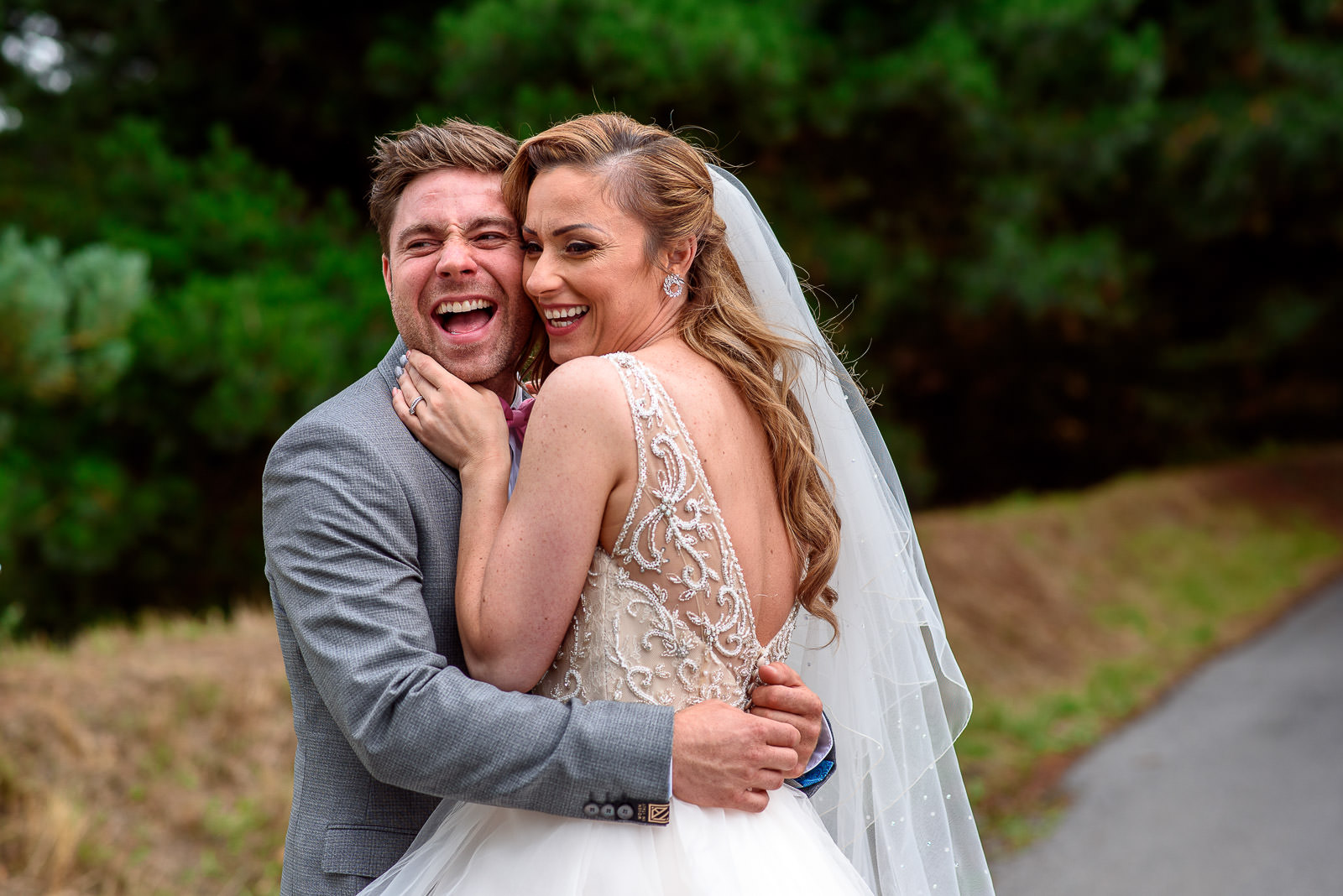 Couple taking happy Wedding photos at Oaks Farm Weddings in Croydon