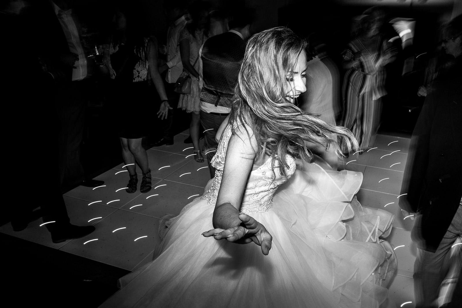 Bride dancing at her wedding party at Oaks Farm Weddings Croydon