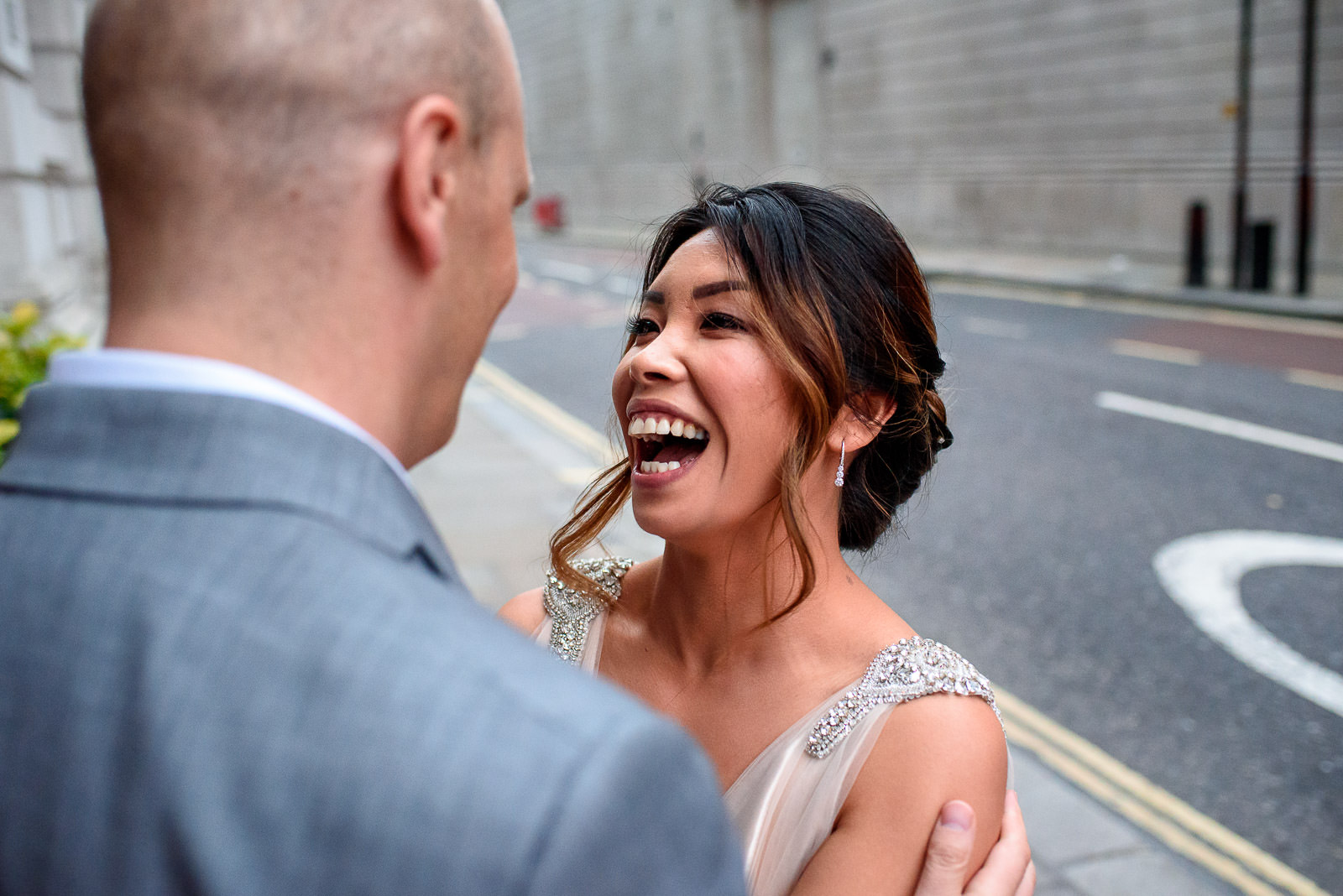 couple laughing while taking wedding photos at The Ned in London