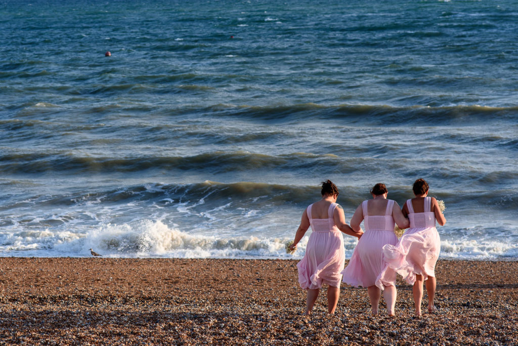 Bridesmaids walking on Brighton Beach