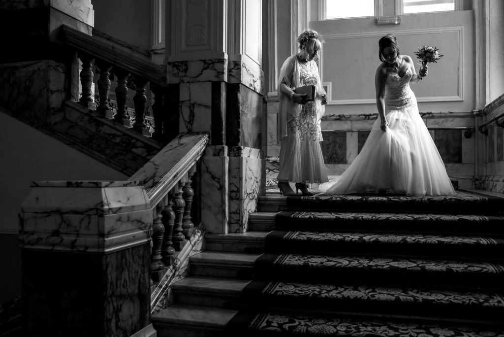 Bride on the stairs of Brighton Grand Hotel