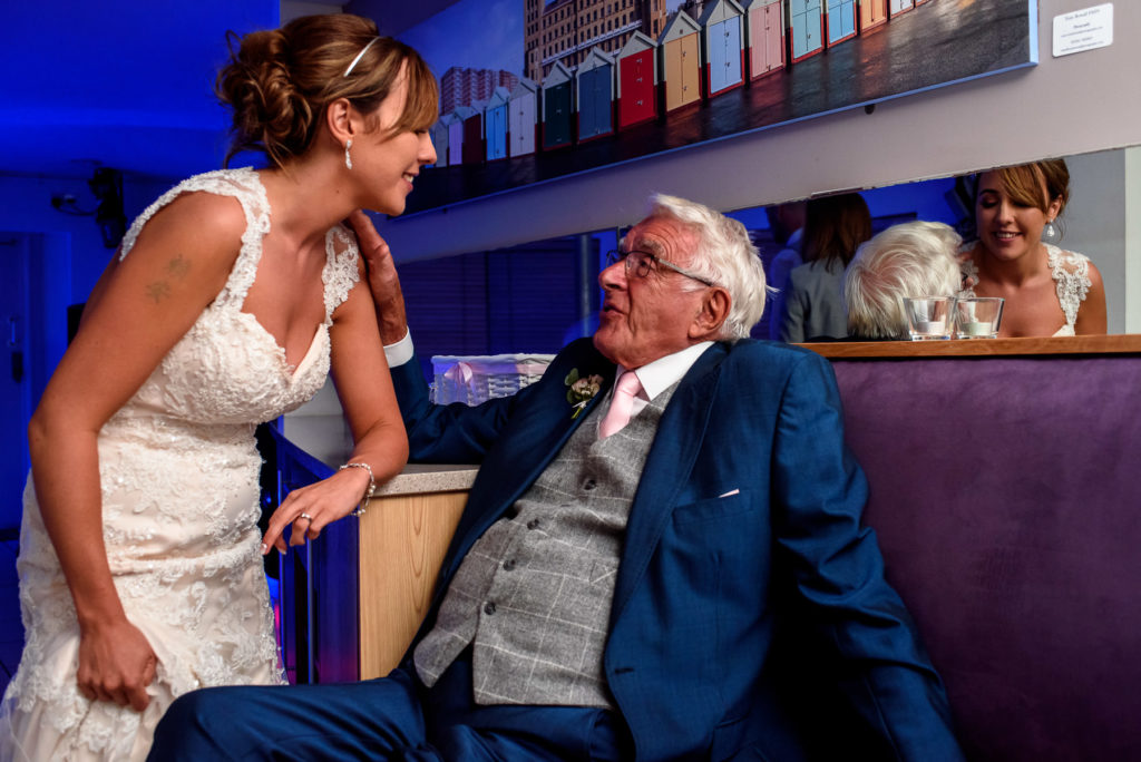 Bride having a laugh with her grandad