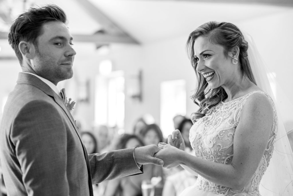 couple exchanging rings at Oaks Farm Wedding