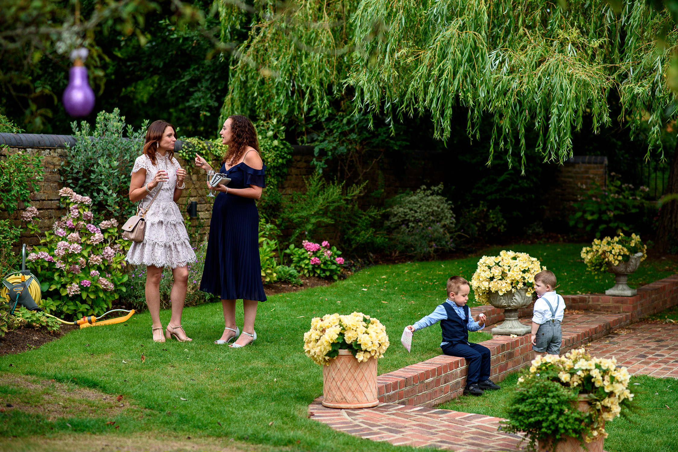 guests chatting in the garden at Oaks Farm Wedding