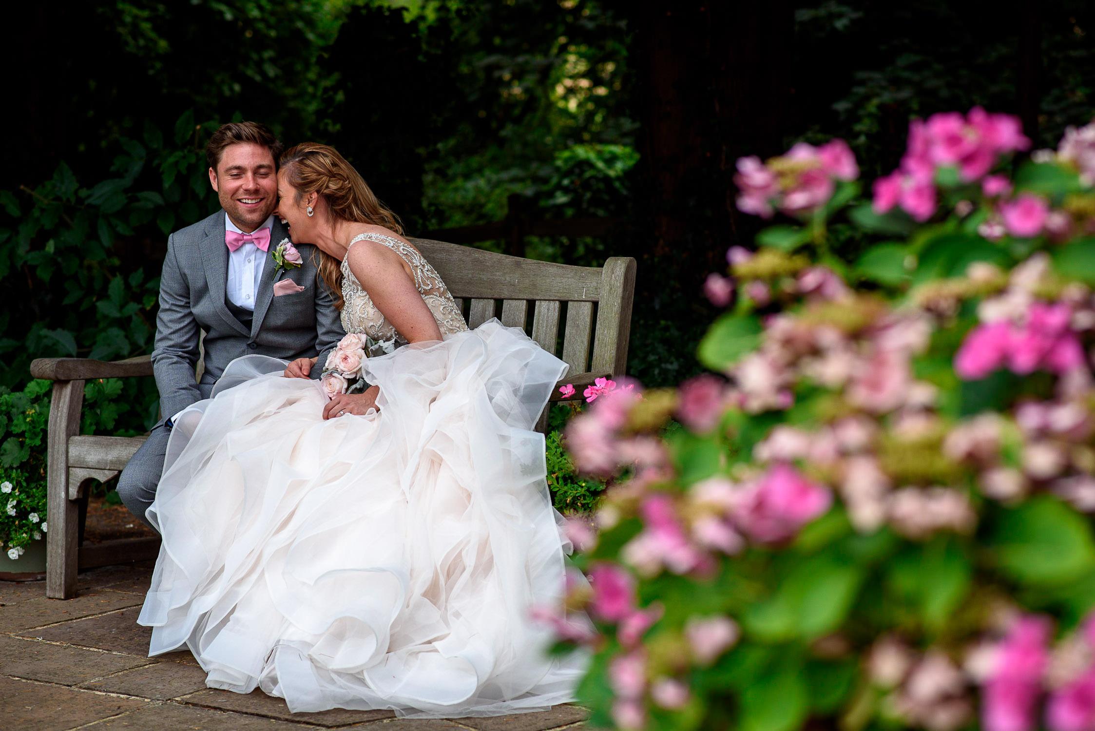 wedding couple laughing during photo shoot at Oaks Farm Wedding