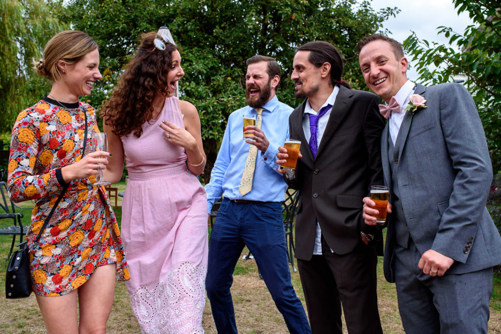 guests laughing at Oaks Farm Wedding