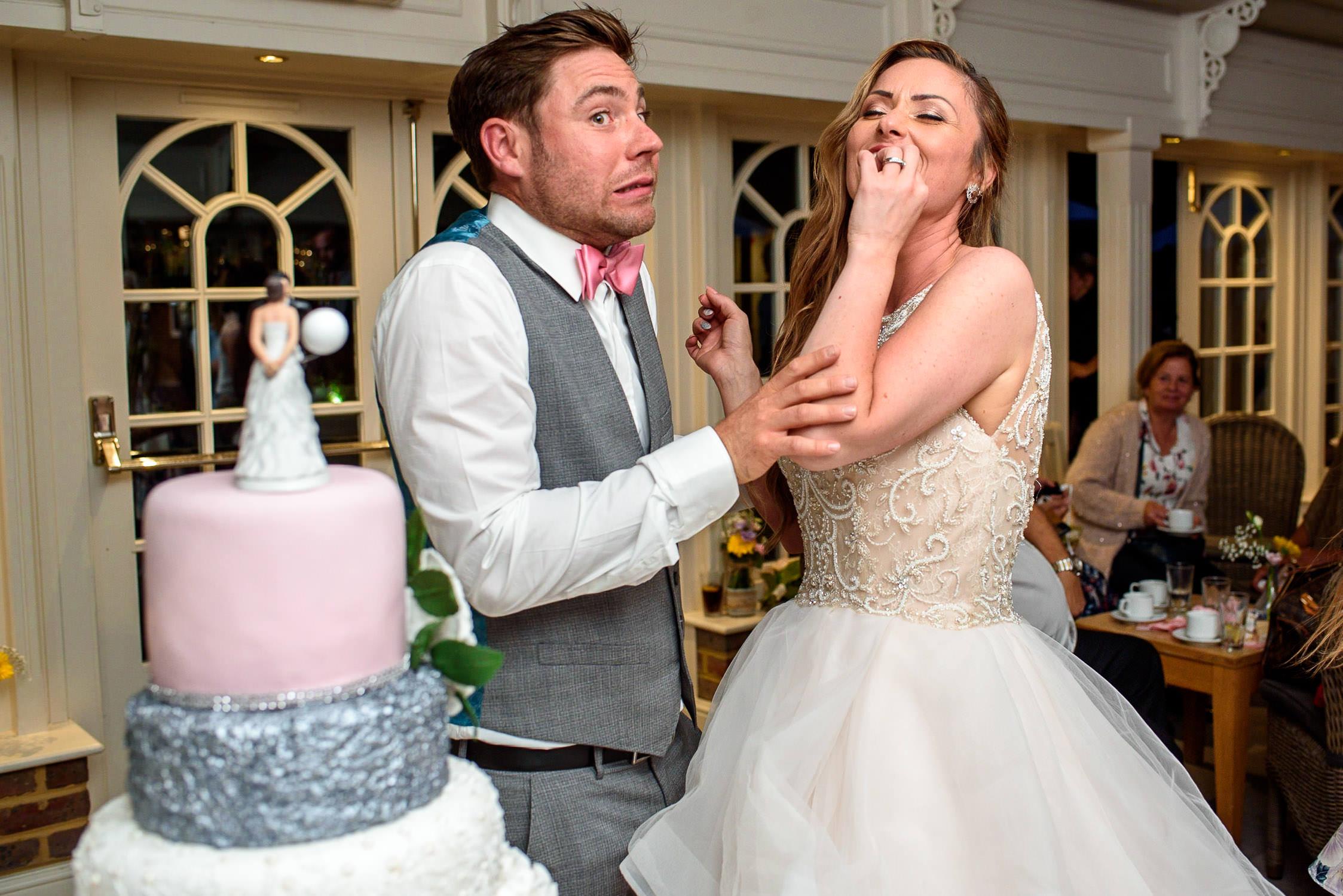 bride and groom cutting the cake at Oaks Farm Wedding