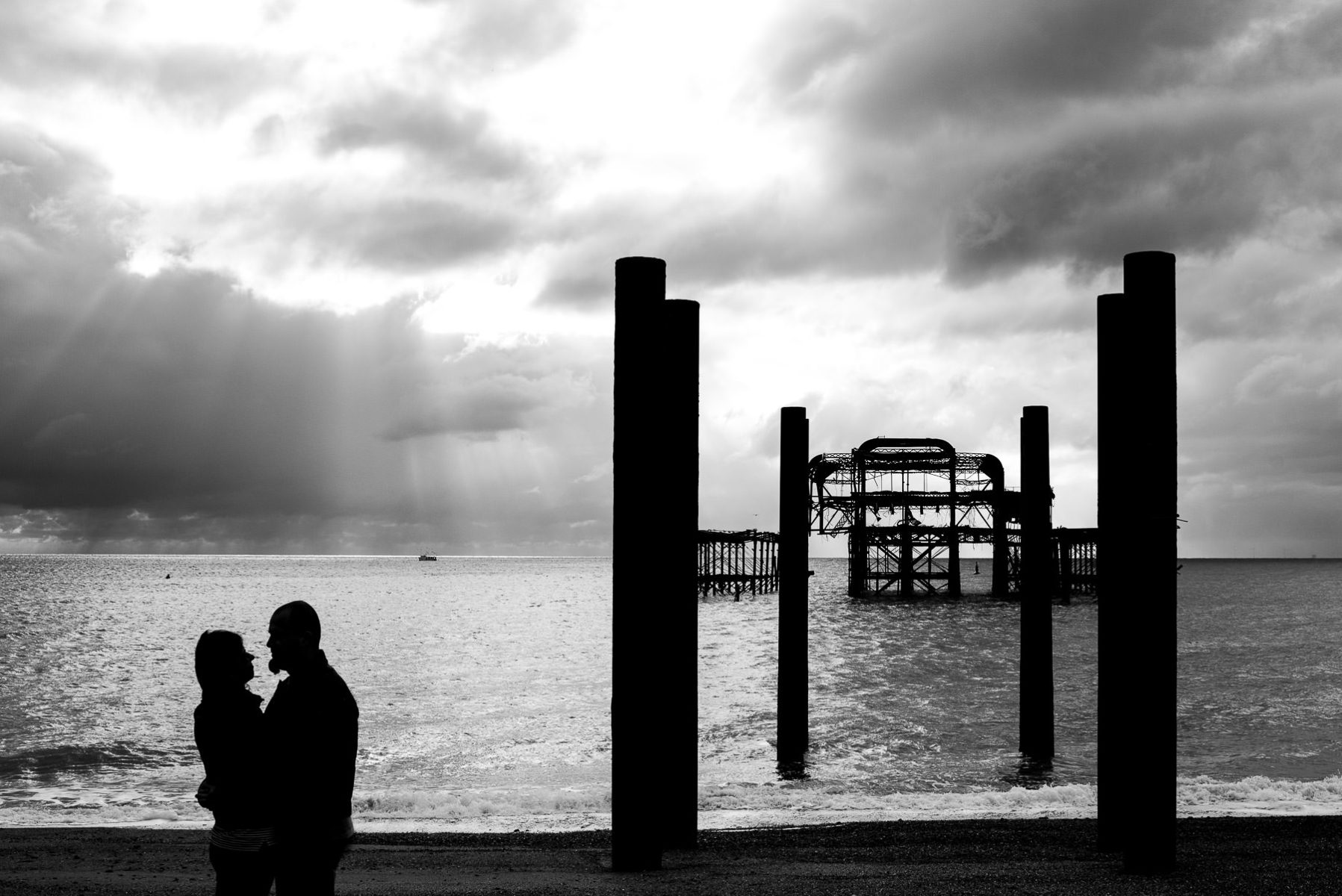 couple silhouette by West Pier Ruins in Brighton