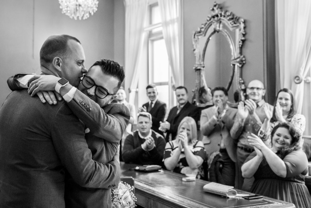 gay couple celebrating their first kiss at Brighton Town Hall