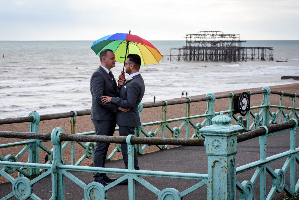 same sex couple photo shoot in front of Brighton West Pier ruins