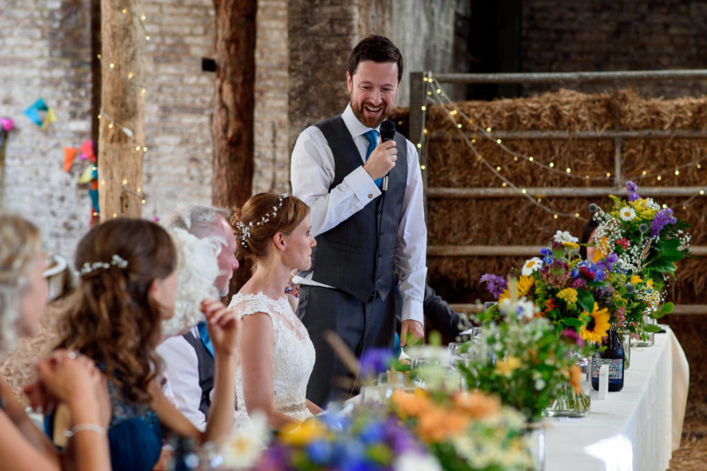 Groom giving speech at wedding