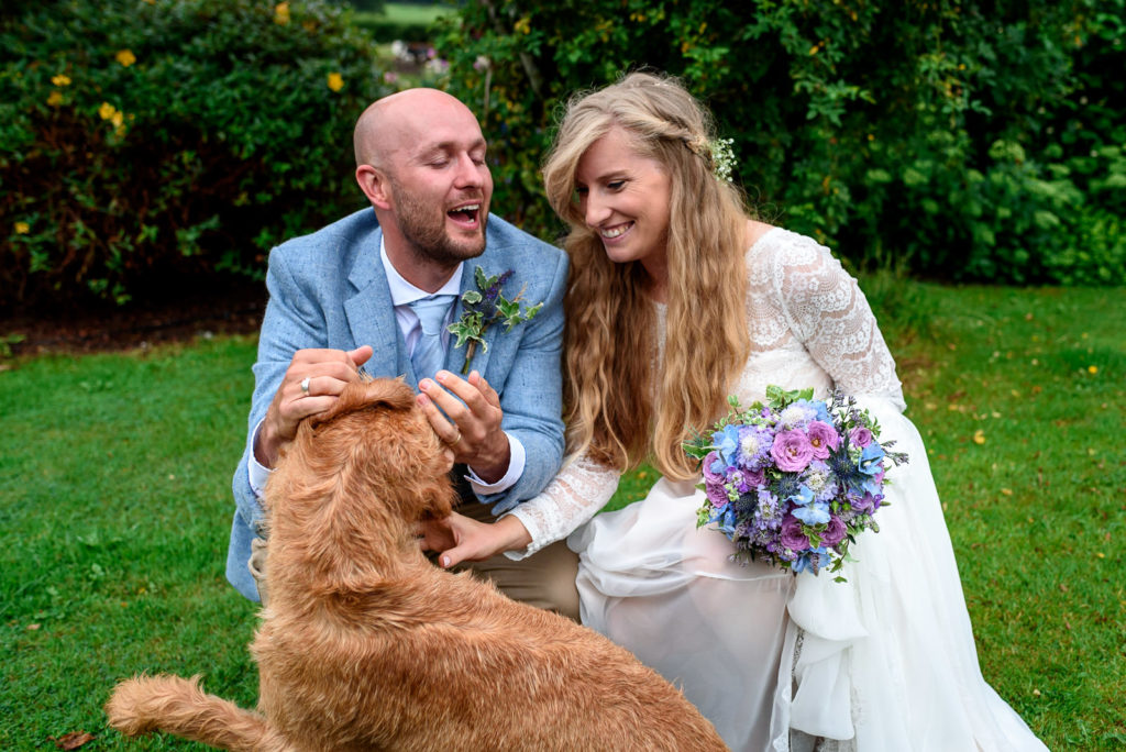 Wedding couple taking photos with their dog