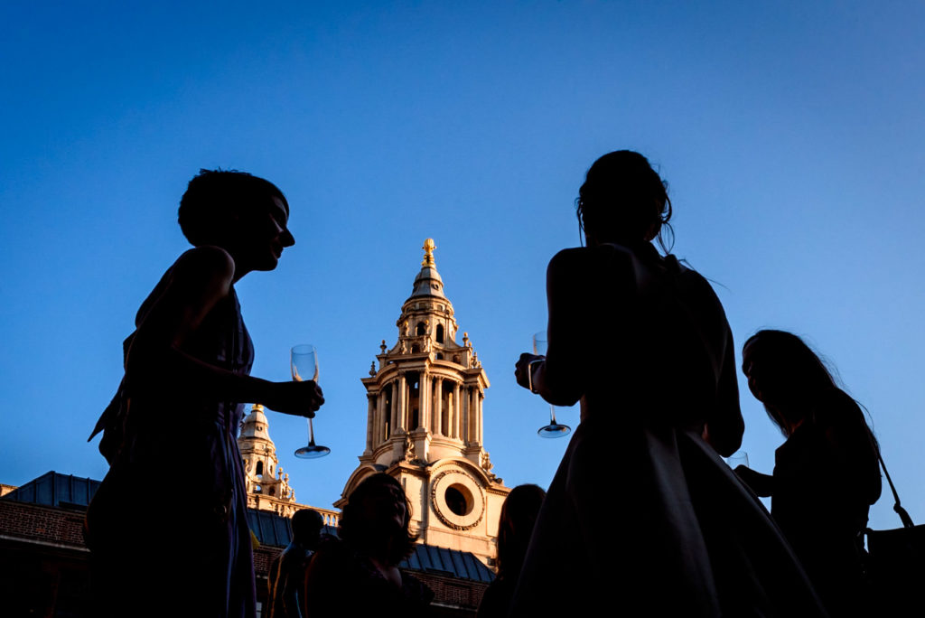 wedding guests enjoying view of St Paul's Cathedral from The Happenstance