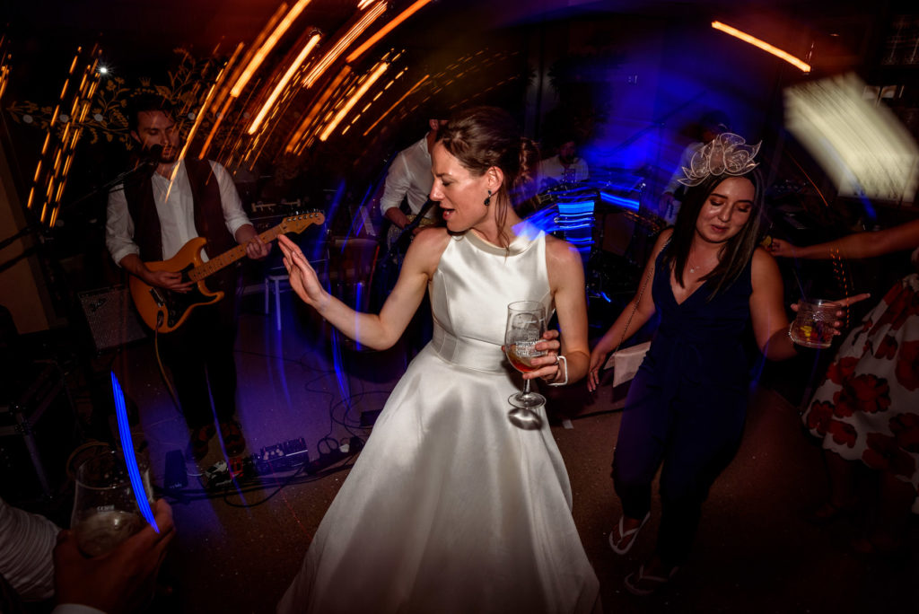 bride dancing with the band at The Happenstance wedding venue