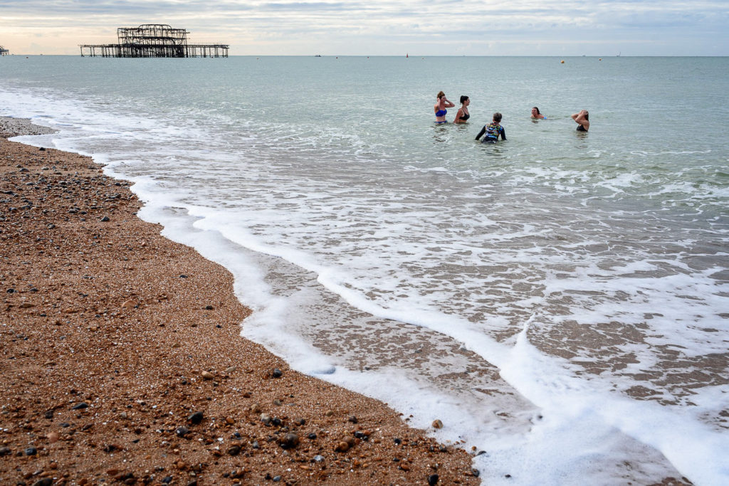 bride and bridesmaids swimming in Brighton Sea