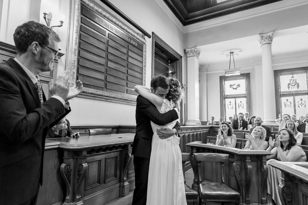 couple hugging after wedding ceremony at Brighton Town Hall
