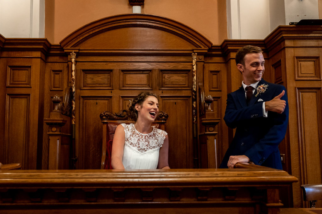bride and groom signing the registry at Brighton Town Hall Wedding