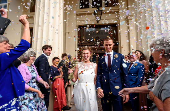 wedding confetti photo in front of Brighton Town Hall